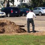 Elmer shoveling mulch.