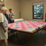 Sandy, Sally and Liz quilting.
